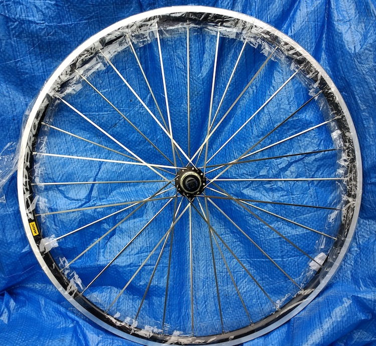 Rear wheel, radial-tangent lacing, bladed spokes
