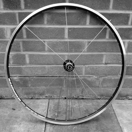 Gear side outer spokes laced